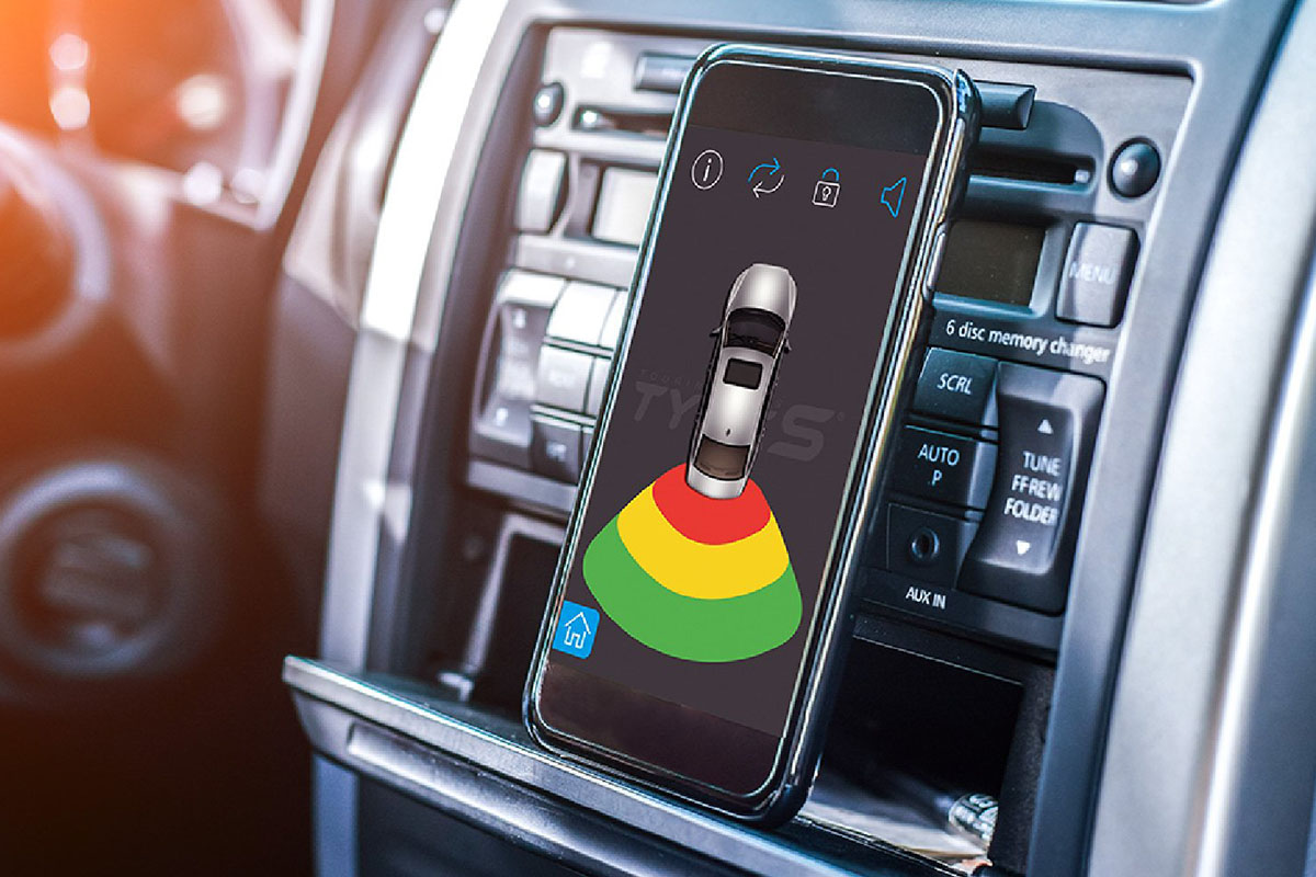 A phone on a car console, displaying a parking sensor app.