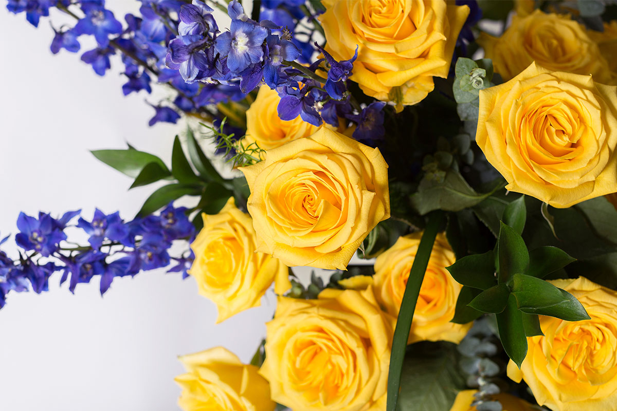 A yellow and purple flower bouquet.
