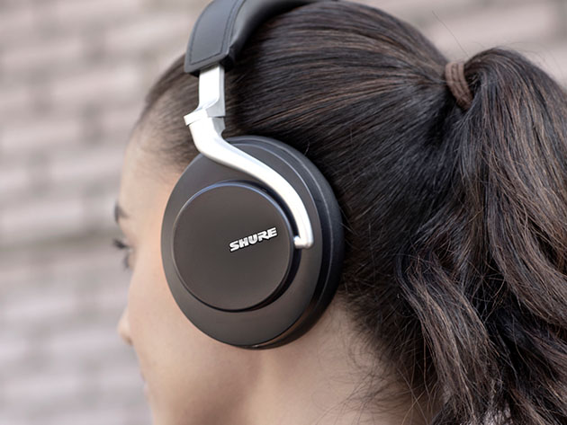 A person wearing Shure headphones