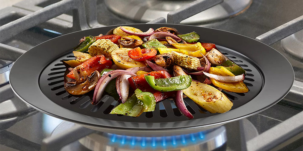 A grill pan on an oven range cooking vegetables