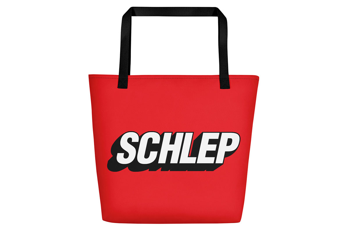 "A red canvas bag that says ""SCHLEP"""