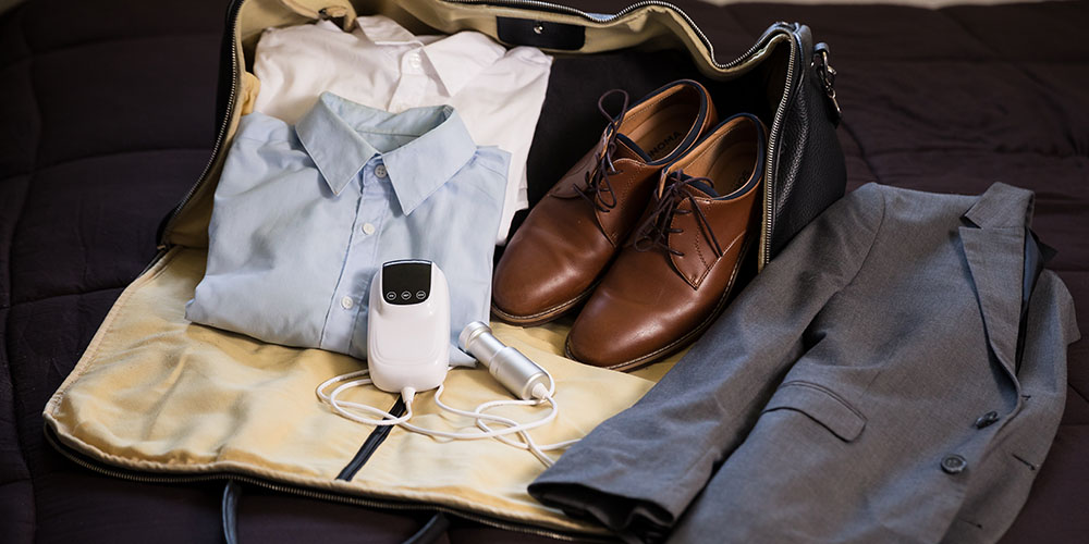 Assorted clothing, a pair of shoes and a Sonic Soak Ultrasonic cleaner
