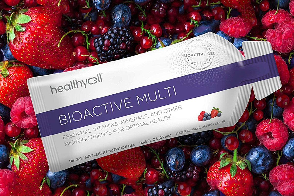 A packet of healthycell Bioactive Multi, with assorted berries in the background