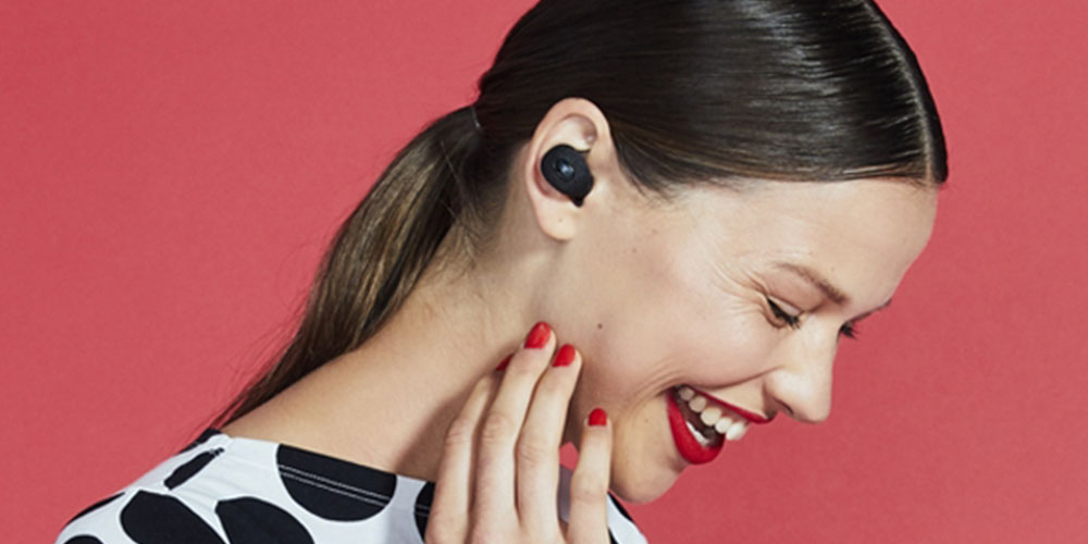 A person listening to earbuds